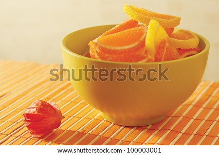 Fruit jelly with physalis on a bamboo table cloth still life - stock photo