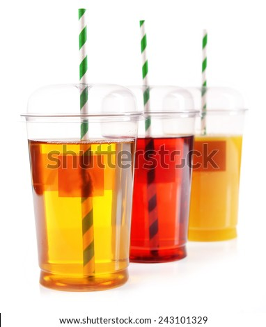 Fruit juices in fast food closed cup with tube and slices isolated on white - stock photo