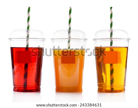Fruit juices in fast food closed cups with tubes isolated on white - stock photo