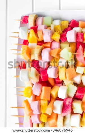 fruit kebabs, vaguely healthy party food - stock photo