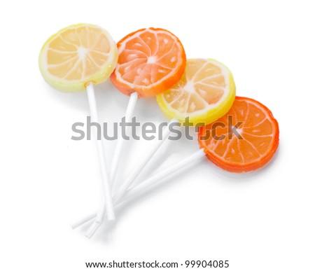 fruit lollipops isolated on white - stock photo