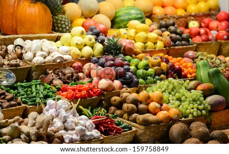 Fruit market with various colorful fresh fruits and vegetables - Market series - stock photo