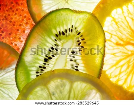 fruit mix (fig, lime, lemon, orange, kiwi) - stock photo