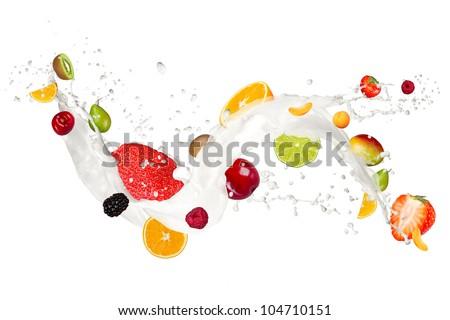 Fruit mix in milk splash, isolated on white background - stock photo