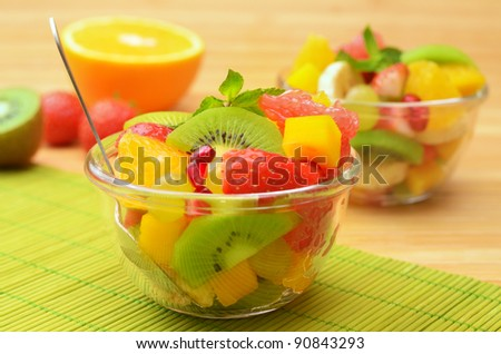 Fruit mix salad on the table - stock photo