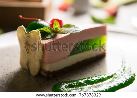 fruit mousse cake with apple jam, colorful mousse dessert