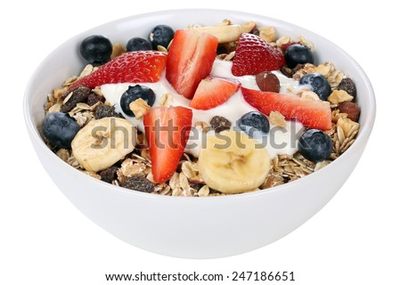 Fruit muesli for breakfast in bowl with fruits like raspberry, blueberries, banana and strawberry isolated - stock photo