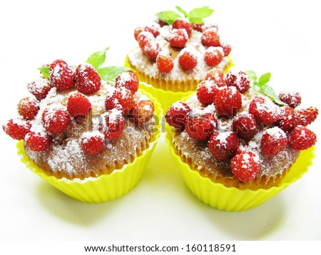 fruit muffin cakes with wild strawberry berries