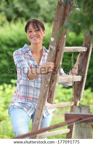 Fruit picker in the countryside - stock photo