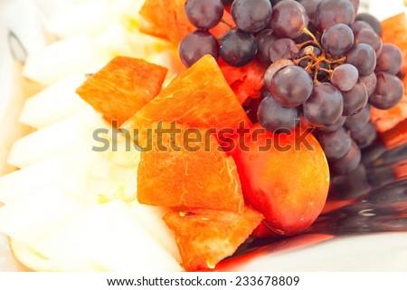 Fruit plate. Grape, peach, watermelon, cantaloupe - stock photo