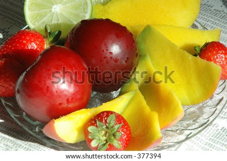 fruit platter with the morning news - stock photo