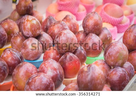 Fruit plums in Basket at Market,selective focus. - stock photo