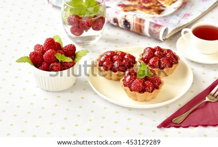 Fruit raspberry cakes on a table