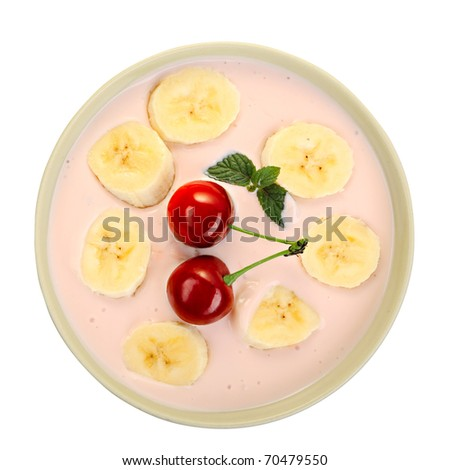 fruit salad - banana, red cherry and yogurt in a bowl - stock photo