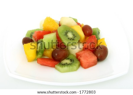 Fruit salad cocktail on a plate, macro close up isolated on white, with copy space - stock photo