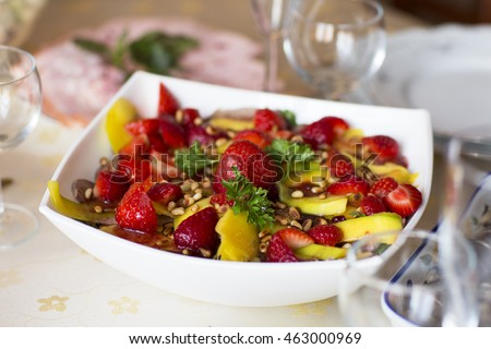 Fruit salad, dessert. Strawberries and mangoes in sweet and sour sesame sauce.