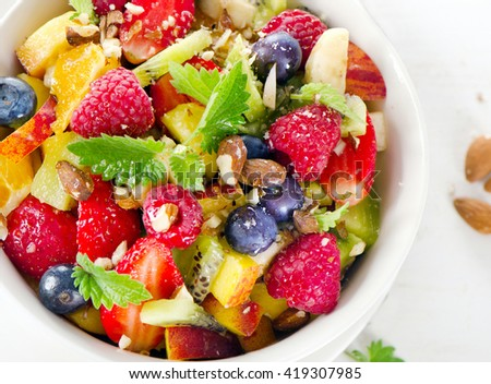 Fruit salad for sweet healthy breakfast. Top view - stock photo