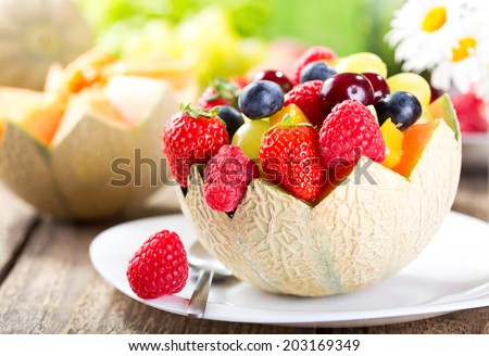 fruit salad in a half of melon - stock photo