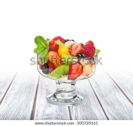fruit salad in a ramekin on white wooden table