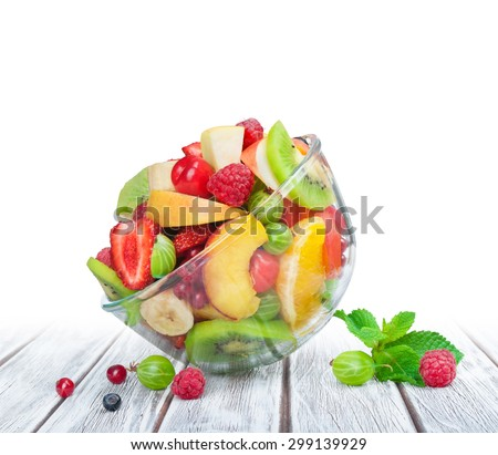 fruit salad in glass bowl white wooden table - stock photo
