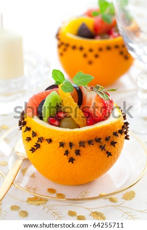 Fruit salad in  hollowed-out oranges studded with cloves   for Christmas - stock photo