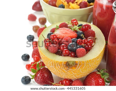 Fruit salad in melon on a white background
