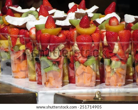 fruit salad in plastic mugs for sale - stock photo