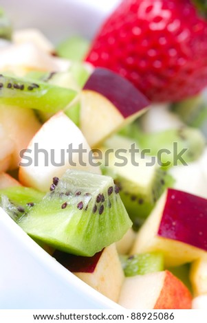 Fruit salad in plate, closeup - stock photo