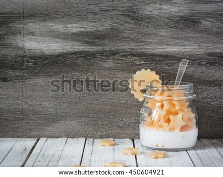 Fruit salad made of cantaloupe in the jar on the grey wooden background. Fitness food concept with text space.
