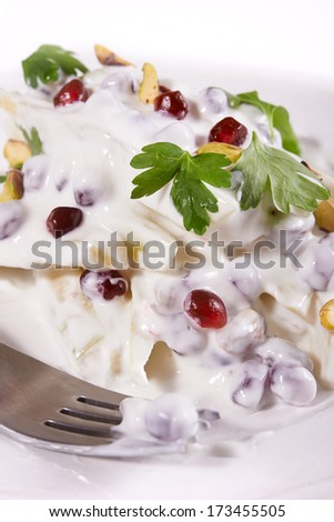 fruit salad with cream and pomegranate