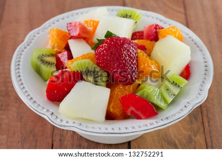 fruit salad with strawberry on the plate