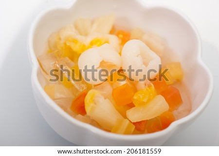 fruit salad with watermelon and melon balls. decorate with peach and mint,Fruit salad in syrup - stock photo