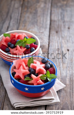 Fruit salad with watermelon shaped as stars and blueberries - stock photo