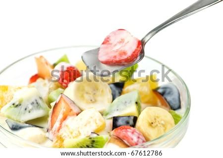 fruit salad with yogurt closeup - stock photo