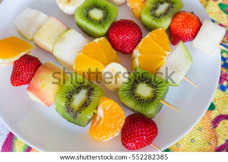 fruit skewers on the plate the concept of healthy eating