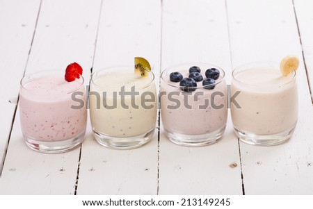 Fruit smoothies with blueberries , strawberry, kiwi and banana