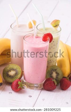 Fruit smoothies with  strawberry, kiwi & banana - stock photo