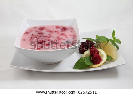 fruit soup on white plate isolated on white background - stock photo