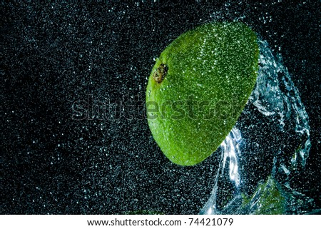 fruit splashing in the water - stock photo