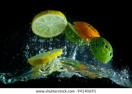 fruit splashing in the water - stock photo