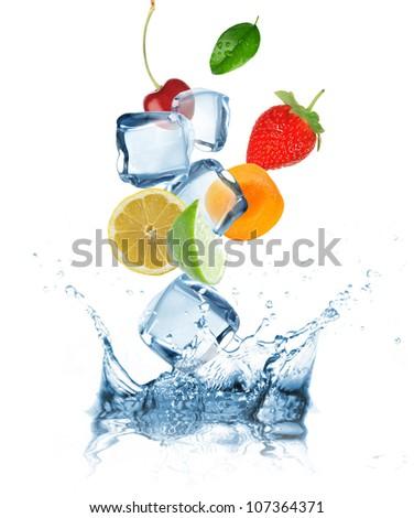 Fruit splashing into water - stock photo