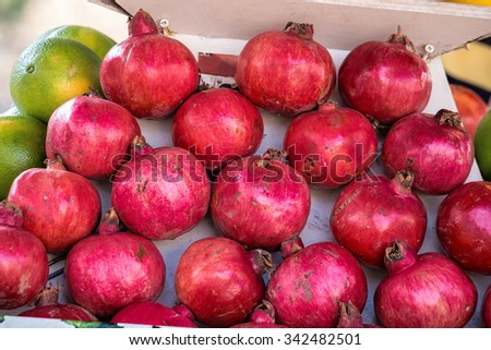 Fruit stand with pomegranate and Mandarin orange at old city of Nazareth, Israel - stock photo