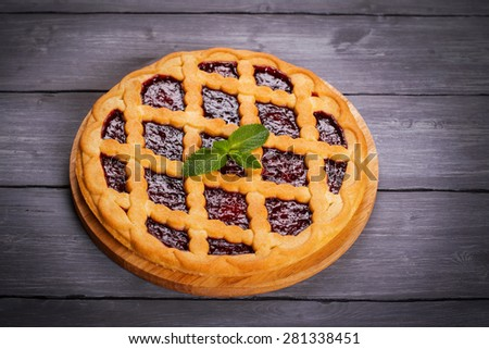 Fruit tart with cherry filling and fresh cherry and mint, selectIve focus - stock photo