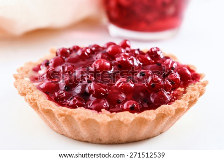 Fruit tart with currant, cream and jelly