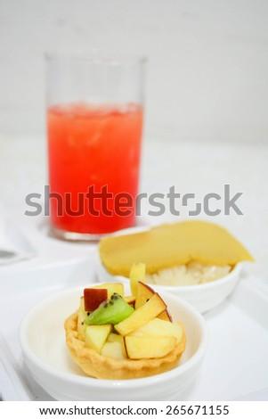 fruit tart with punch juice - stock photo