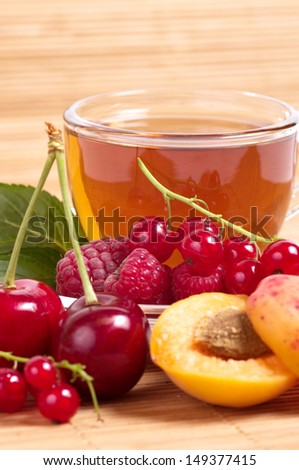 Fruit tea in cup with mix berry - stock photo