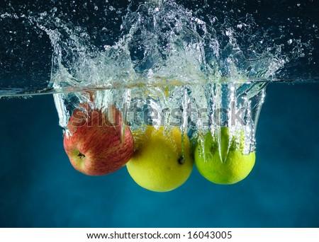 Fruit thrown in water - stock photo