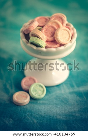 Fruit Tingles Life Saver Candy on stand against blue background - stock photo