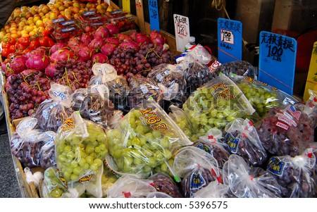 Fruit vendor display at Chinatown - stock photo