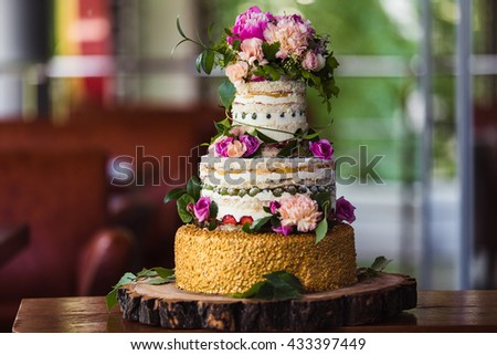 fruit wedding cake with flowers on a cut tree